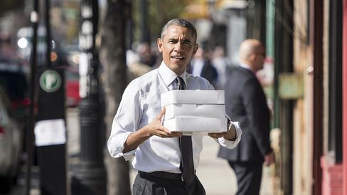 President Barack Obama brings doughnuts and pastries to Democratic campaign volunteers Oct. 20, 2014, in Chicago, Ill.