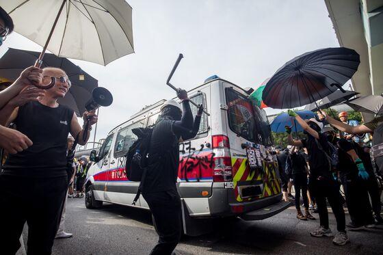 Hong Kong Police Strain Under Pressure to Solve Political Crisis