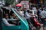 Pedestrians make their way through traffic in Chandni Chowk in the Old Delhi area of New Delhi, India.