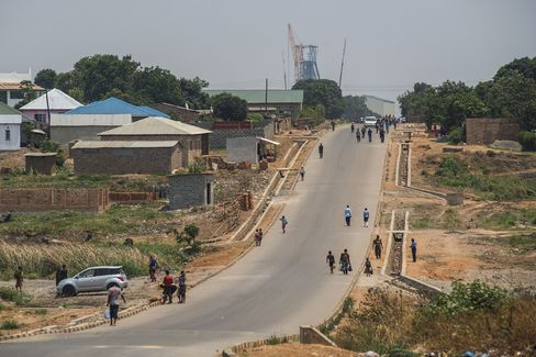 Residents walk towards the Mopani copper mine in Kitwe.
