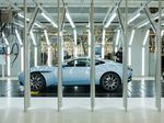 An Aston Martin DB11 automobile sits in the final inspection area at the Aston Martin Lagonda Ltd. manufacturing and assembly plant in Gaydon, U.K.