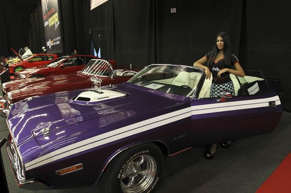 A model poses in front of a Dodge Challenger (1971) car displayed during the Lebanon Motorsport and Tuning Show (LMTS) on June 13, 2015 in Jounieh, north of Beirut.  AFP PHOTO / ANWAR AMRO        (Photo credit should read ANWAR AMRO/AFP/Getty Images)