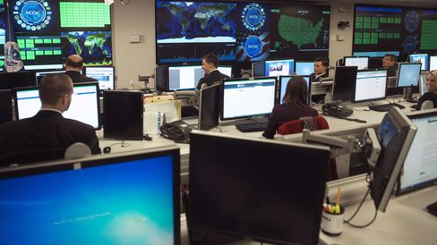 Staff members sit at their work stations at the National Cybersecurity and Communications Integration Center in Arlington, Virginia, on January 13, 2015.
