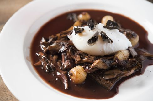 A softly poached duck egg in red wine sauce.