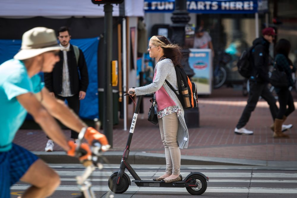 Electric Scooters, Bikes Compete for City Streets - Bloomberg