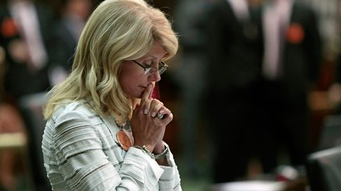 State Sen. Wendy Davis (D-Ft. Worth) contemplates her 13-hour filibuster after the Democrats defeated the anti-abortion bill SB5, which was up for a vote on the last day of the legislative special session June 25, 2013 in Austin, Texas.