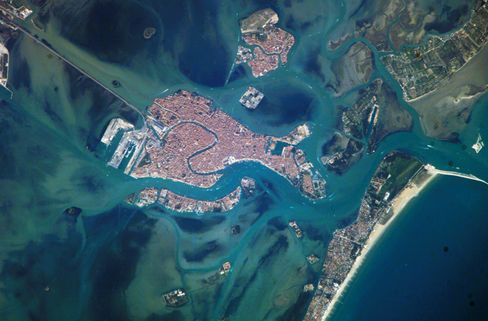 The city of Venice as seen from space. To the south, past Giudecca, sit San Clemente and Isola della Rosa, just visible here.