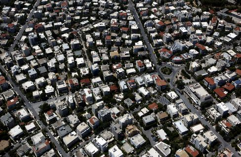 Hedge Funds Lured by Greek Housing Debt Paying 22%