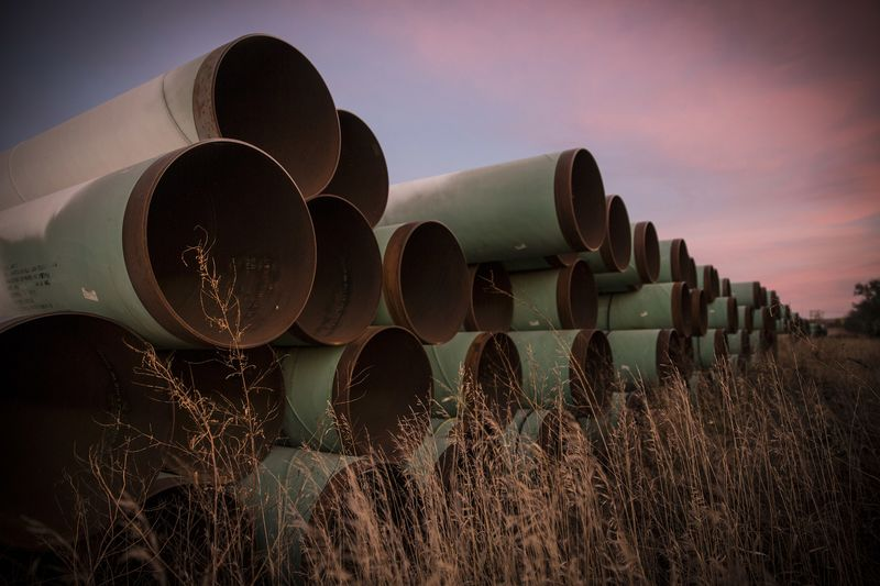 Miles of unused pipe, prepared for the proposed Keystone XL pipeline, sit in a lot on Oct. 14, 2014 outside Gascoyne, North Dakota.