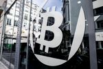 A logo sits on the windows of the offices of La Maison du Bitcoin bank.
