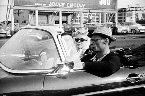Marilyn Monroe and playwright husband Arthur Miller tool around town with the top down.