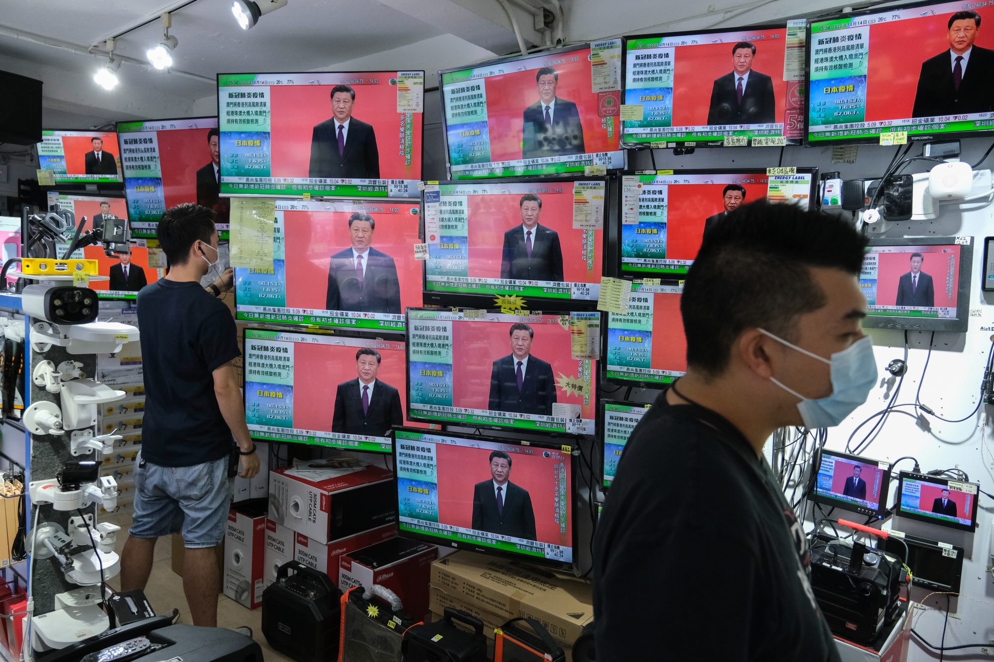 President Xi Jinping's speech in Shenzhen is broadcasted inside a store in Hong Kong, Oct. 14.