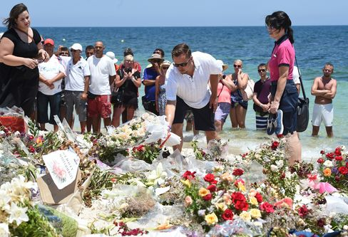 Tourists Lay Flowers on a Beach in Sousse