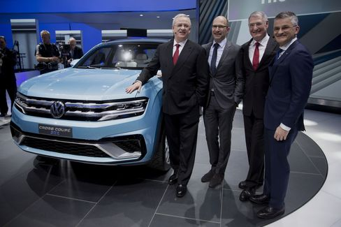Volkswagen Chief Executive Officer Winterkorn (left) and Michael Horn, president and chief executive officer of Volkswagen Group of America (right), with two other VW executives at the the 2015 North American International Auto Show.