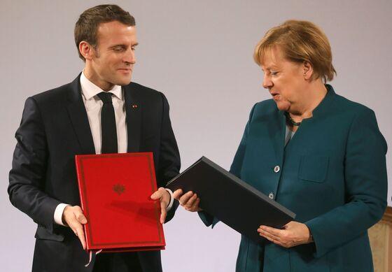 Merkel Seeks to Unite European Defense Industry as Threats Loom