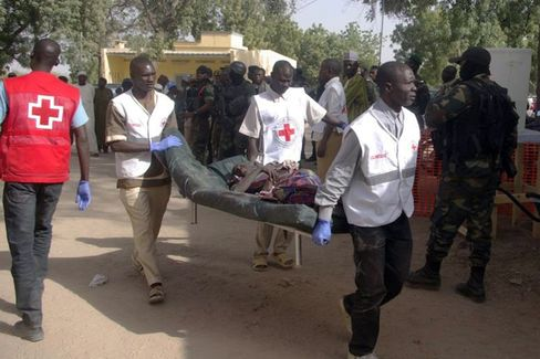A wounded woman is carried on a stretcher in Mora, on Jan. 29.