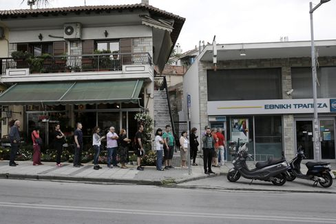 Customers queue to use an automated teller machine (ATM) outside a National Bank of Greece SA bank branch in Thessaloniki, Greece, on Saturday, June 27, 2015.