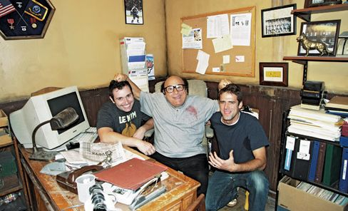 Stutz, left, and his friend, right, with star Danny DeVito