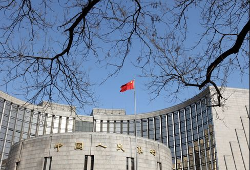 The Chinese flag flies above the People's Bank of China