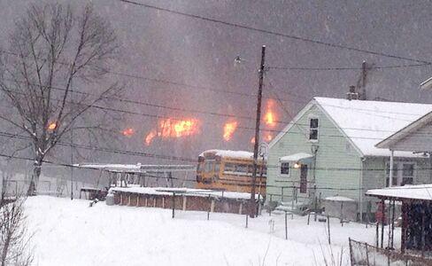 A fire burns after a train derailment near Charleston, West Virginia on Feb. 16, 2015.