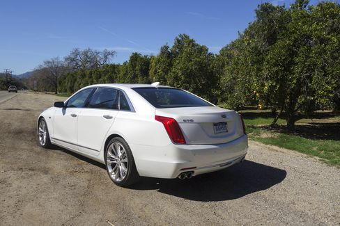 The rear of the car is short but wide. The vertical taillights and bright LED headlamps recall the long fins of vintage Cadillacs.
