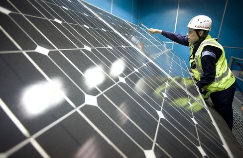 An Installation Trainee Secures A Solar Panel