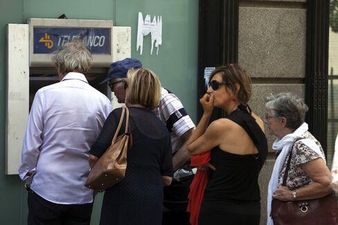 Spanish Banks Bleeding Cash Cloud Bailout Debate