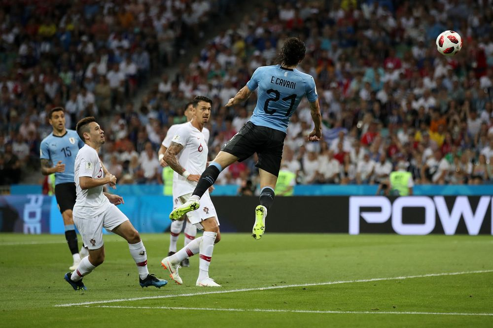 5893082f7 Edinson Cavani of Uruguay scores his team s first goal during the 2018 FIFA  World Cup Russia