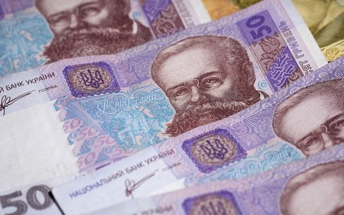 Ukrainian Hryvnia And Russian Ruble Currency Banknotes As Ukraine Tensions Rise