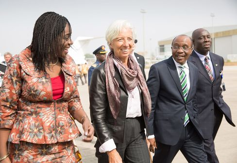 International Monetary Fund Managing Director Christine Lagarde (C) is escorted by Nigeria's Finance Minister Kemi Adeosun (L) and Nigeria's Central Bank Governor Godwin Emefiele (R) upon arriving at the Nnamdi Azikiwe International Airport.