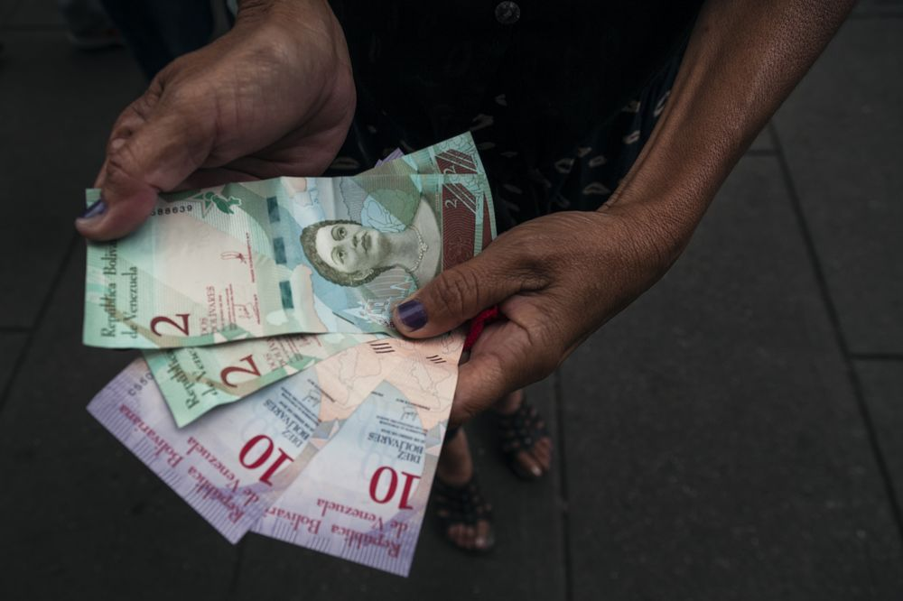 A Person Displays New 2 And 10 Sovereign Bolivar Banknotes In Caracas On Sept 14