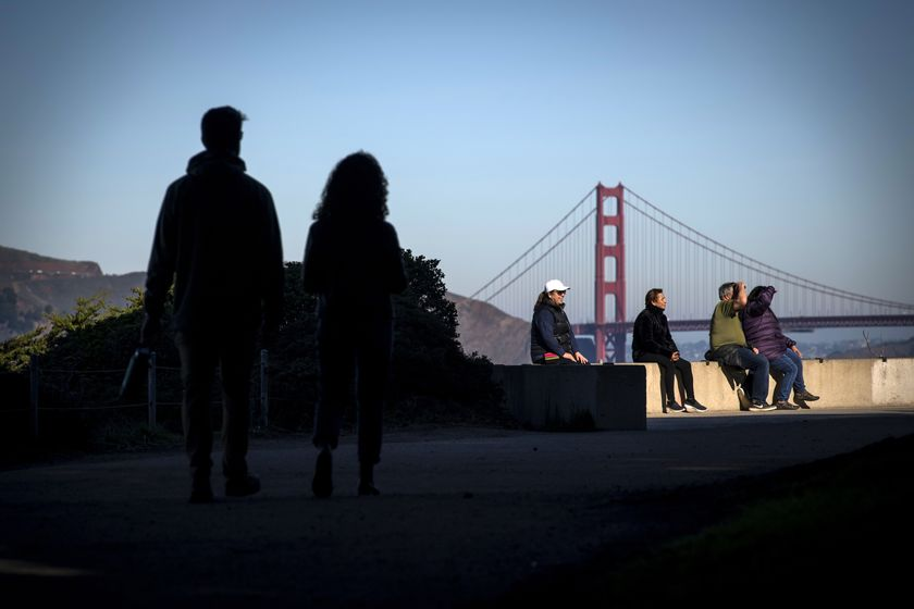 Visitors gather on a trail at Golden Gate National Recreation Park in San Francisco, California, U.S.