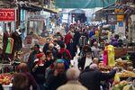 People walk through a marketin Jerusalem.