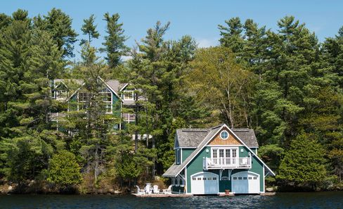 A large cottage and its boat house on the shores of Lake Rosseau. Photographer: James MacDonald/Bloomberg