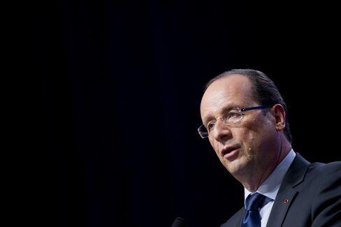 Dreaded A-Word Looms in France as Hollande Seeks Spending Cuts