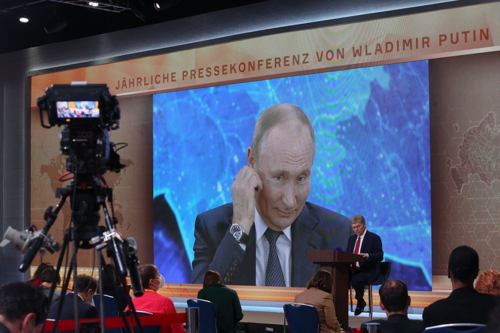 Vladimir Putin delivering his annual news conference at the Crowne Plaza World Trade Centre in Moscow.