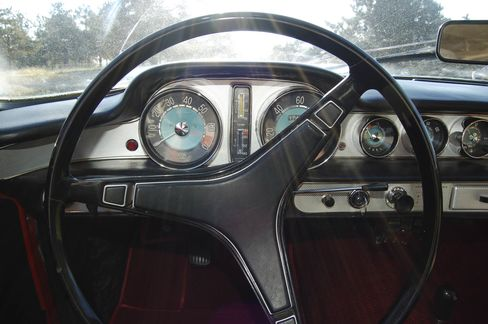 The car came with round dials on the dash and a three-spoke steering wheel.
