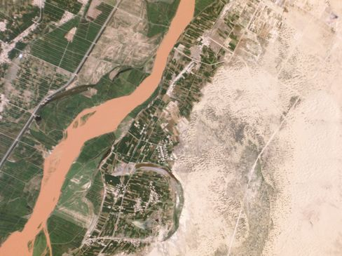 Agricultural lands abut the Yellow River, just outside of Touzha in Pingluo County, China, where a desertification control project is under way to preserve agricultural lands.