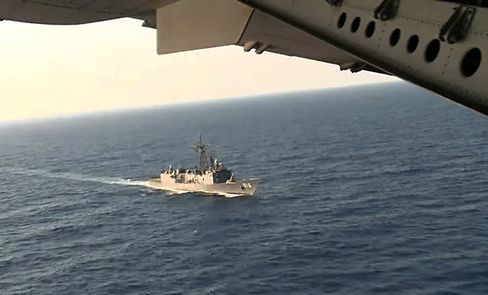 An Egyptian plane flies over an Egyptian ship during the search.