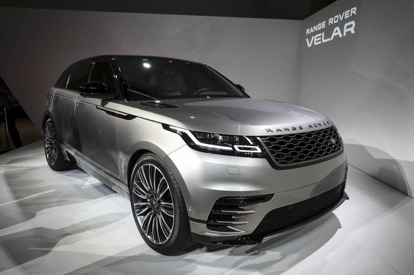 A Range Rover Velar sports utility vehicle (SUV), manufactured by Jaguar Land Rover Automotive Plc, stands during a launch event for the automobile at the Design Museum, in London, U.K., on Wednesday, Mar. 1, 2017. The Velar is critical to reviving parent company Jaguar Land Rovers profitability following recent years of rapid expansion since the British auto manufacturers takeover by Indian carmaker Tata Motors Ltd. Photographer: Simon Dawson/Bloomberg