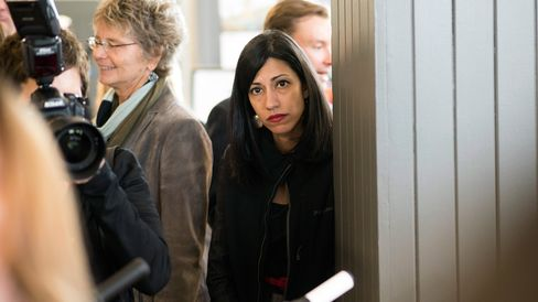 Huma Abedin, a longtime aide to Hillary Clinton, looks on as Clinton speaks to reporters in Cedar Falls, Iowa, on May 19, 2015.