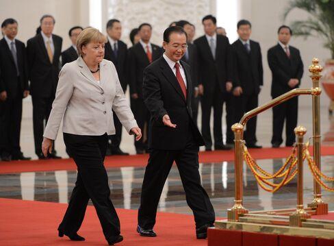 Wen Tells Merkel Spain, Italy, Greece Need to Step Up Overhaul
