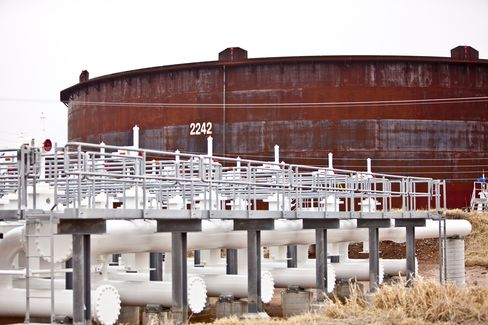Control Manifolds sit Near an Oil Storage Tank in Cushing