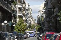 Europe, Greece, Athens, Piraeus Area, 2018: View Of Road And Apartment Buildings