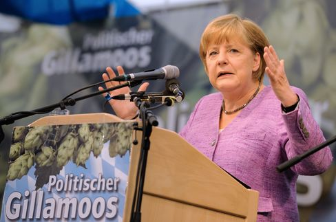 Merkel Attacks Markets in Call for Voter Support to Cut Debt