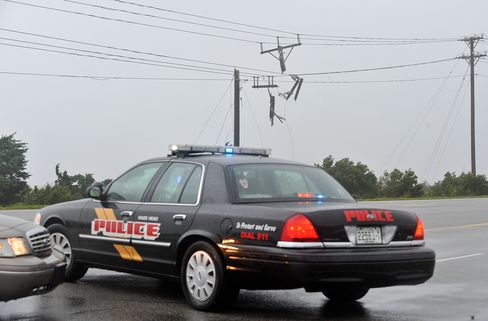 Police Cars Stand Near Damaged Power Line