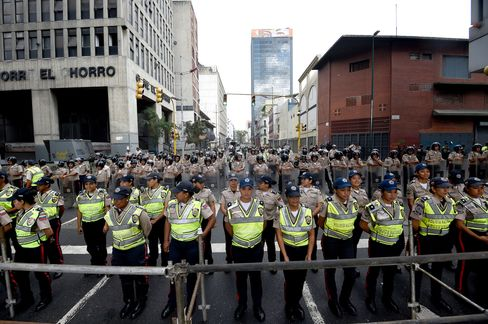 Police officers line up in front of the the National Assembly in Caracas.