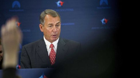 House Speaker John Boehner, a Republican from Ohio, speaks during a news conference following a House Republican Conference meeting in the basement of the U.S. Capitol Building in Washington, D.C., U.S., on Wednesday, Dec. 10, 2014.