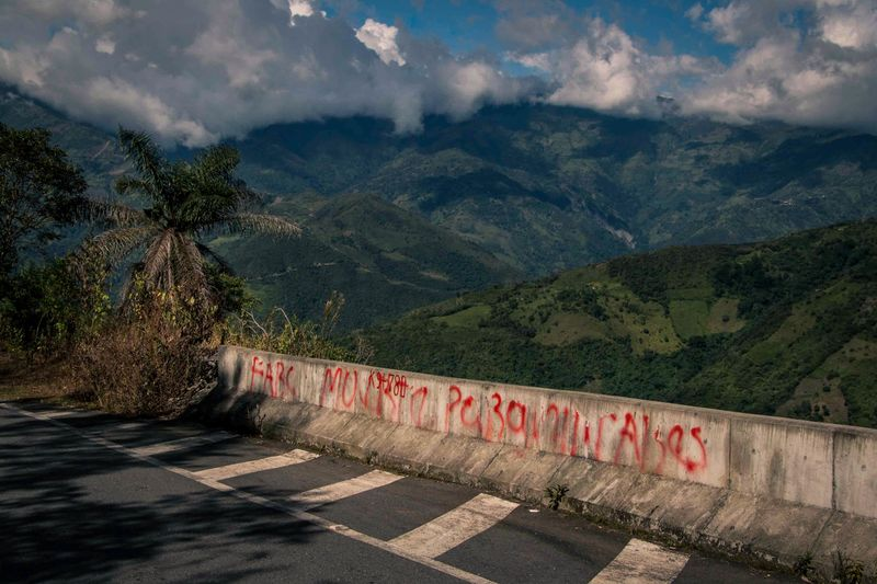 FARC dissidents' graffiti reads 'Death to Paramilitaries' on a road in Toledo.