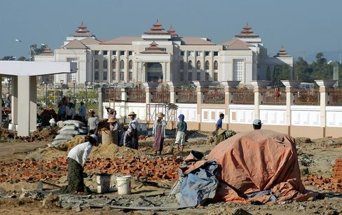 Myanmar laborers work at the construction site of City Hall in the new administrative capital of Naypyidaw.